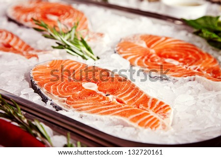Fillet of salmon served with rosemary in ice - stock photo