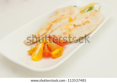 fillet of sole pan fried with flour coating, fresh string beans and diced heirloom tomatoes, a very healthy meal - stock photo