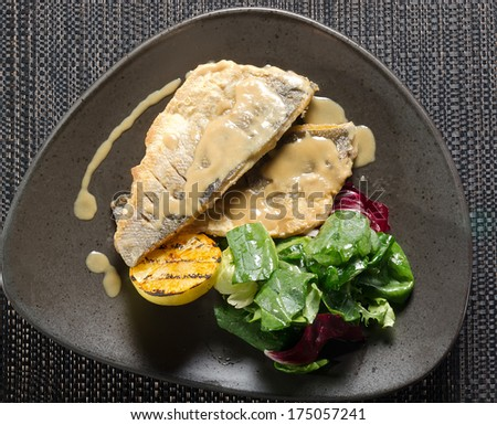 Fillet of white fish and grilled vegetables - stock photo