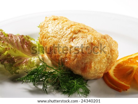 FIlleted Chicken (or Beef) Plate Served with Orange Slice and Salad Leaves. Isolated on White Background