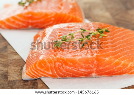 Fillets of fresh Atlantic Salmon ready for the grill - selective focus - stock photo