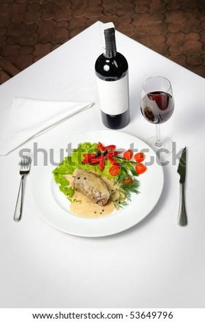 filletto al pepe verde and wine - stock photo