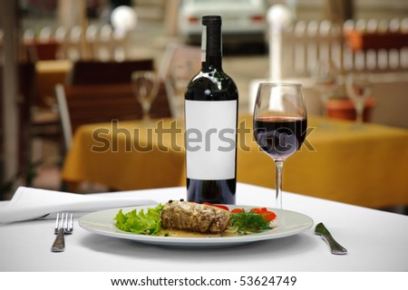 filletto al pepe verde and wine served - stock photo