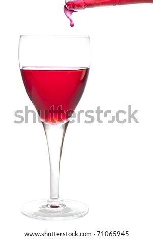 Filling a crystal glass with cherry liquer, drink, on white background - stock photo