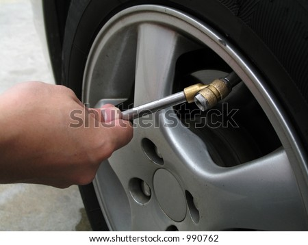 Filling Air Into A Car Tyre - stock photo