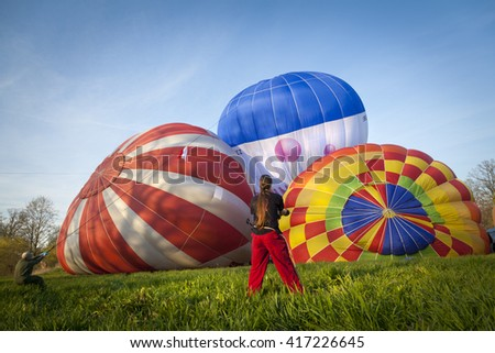 filling  colorful hot air balloons with hot air.Balloon start - stock photo