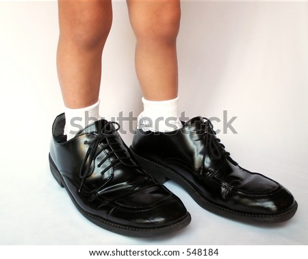 filling daddy's shoes - stock photo