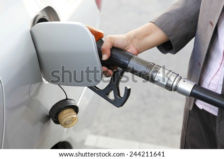 filling gasoline at gas station - stock photo