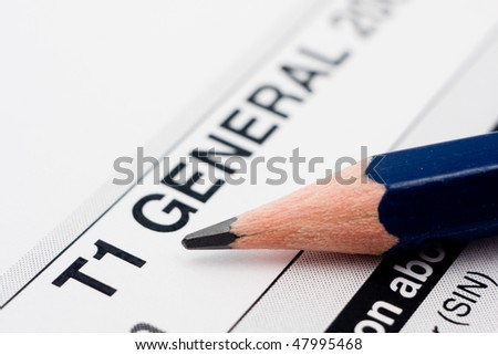 Filling in canadian individual tax form T1 for year 2009 - stock photo