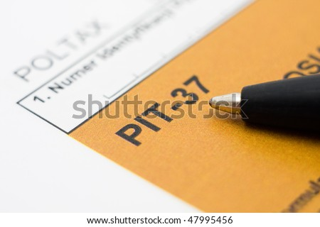 Filling in polish individual tax form PIT-37 for year 2009 - stock photo