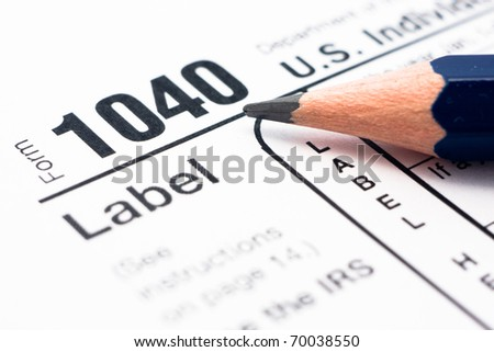 Filling in tax form 1040 for year 2010 - stock photo