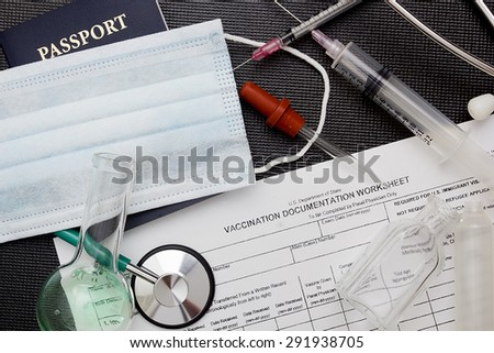 Filling in the form of vaccination. Medical records. - stock photo