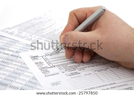 filling income tax form with pen isolated against white background