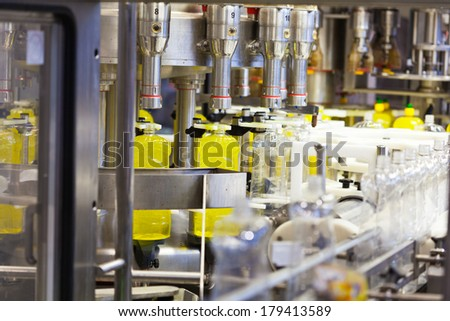 Filling line of plastic bottles, chemical industry - stock photo