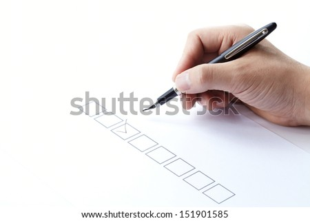 filling of questionnaire a person by a pen on white background  - stock photo