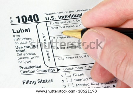 Filling out 1040 Form for tax return - stock photo
