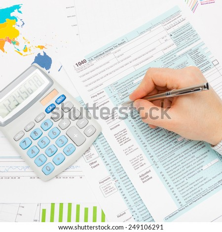 Filling out 1040 US Tax Form - stock photo
