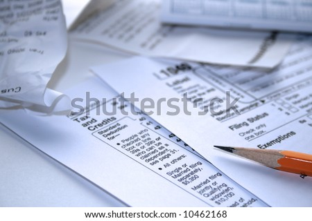 Filling out your income taxes, form 1040 - stock photo