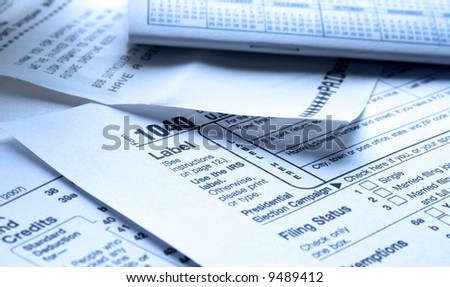 Filling out your 2007 IRS form 1040 Hi-Key and Blue Tint - stock photo