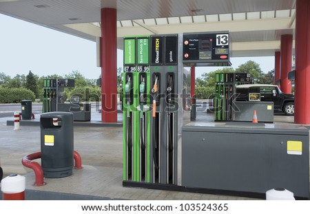 Filling station. Filling of cars by fuel.