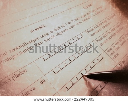Filling survey form  - stock photo