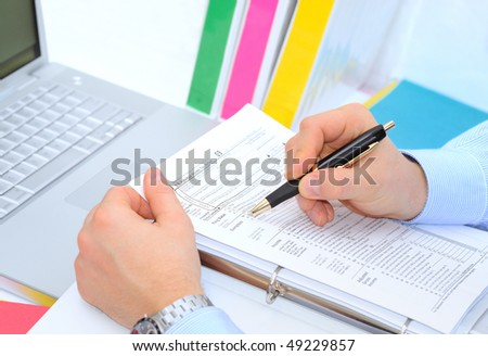 Filling 1040 tax form - stock photo