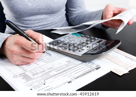 Filling the Form 1040. Standard US Income Tax Return - stock photo