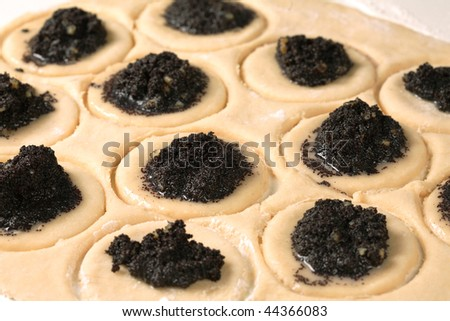 Filling the Hamantashen - A cookie eaten in the holiday of Purim - stock photo