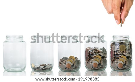 Filling up coins to glass for investment in the future - stock photo