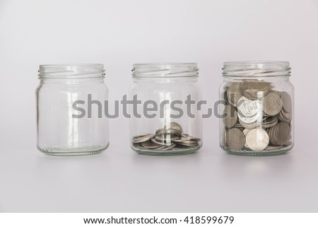 Filling up coins to glass for investment in the future