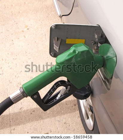 filling up gas at the pump - stock photo