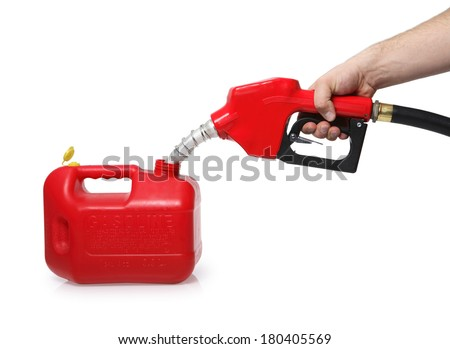 filling up portable gas tank with red nozzle on white  - stock photo