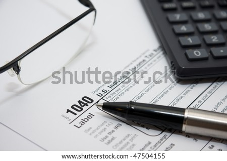 Filling up tax form 1040 for year 2009 - stock photo