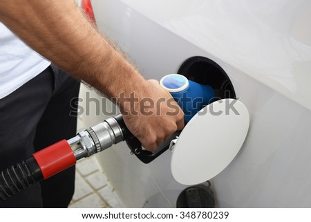 Filling with car gasoline. Service on a gas station. - stock photo