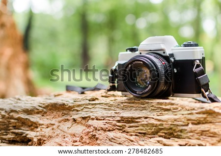Film camera in natural outdoor, vintage look - stock photo