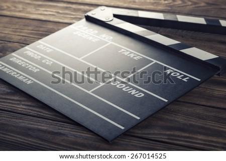 Film. Cinema. vintage photo of movie clapper on wood - stock photo