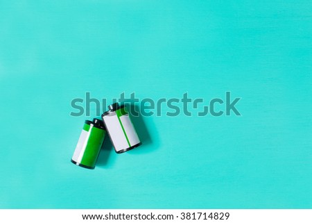 Film 35mm for camera on pastel background. - stock photo