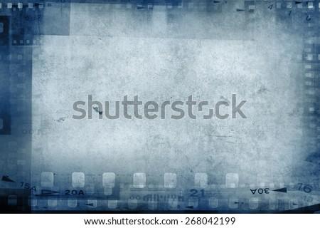 Film negative frames on blue background - stock photo