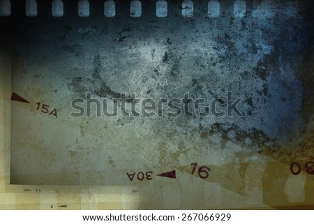 Film negative frames on grungy background - stock photo