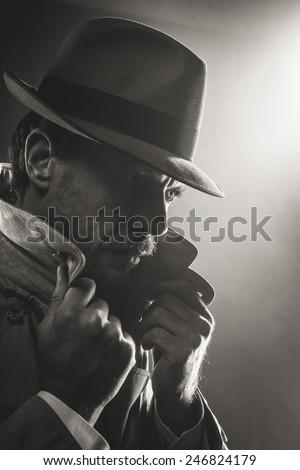 Film noir confident detective with borsalino hat, 1950s style - stock photo