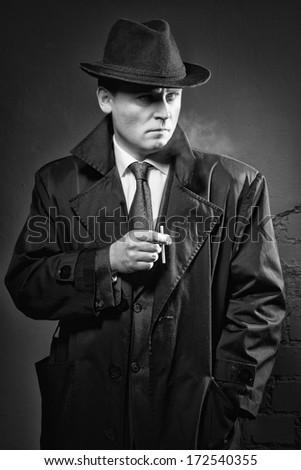Film noir. Retro styled fashion portrait of a detective - stock photo