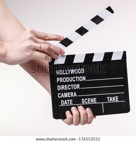Film or Movie clapper in womans hands on white background - stock photo