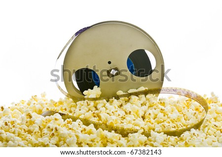 film reel in popcorn isolated on white - stock photo