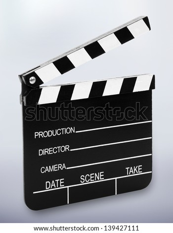 Film slate in front of a background with shadow at the bottom.