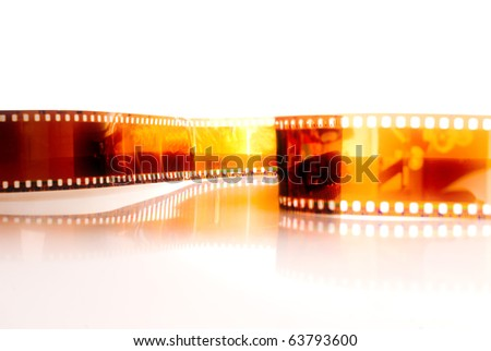 Film strip in front of a white background . - stock photo