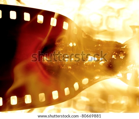film strip  on fire - stock photo