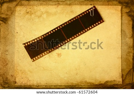 Film tape attached to the paper in grunge style - stock photo