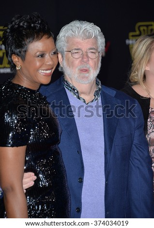 "Filmmaker George Lucas & wife Mellody Hobson at the world premiere of ""Star Wars: The Force Awakens"" on Hollywood Boulevard. December 14, 2015  Los Angeles, CA Picture: Paul Smith / Featureflash - stock photo"