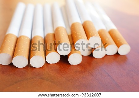 Filter cigarettes on a wooden background