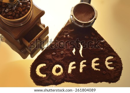 filter holder for coffee machine and coffee in beans - stock photo